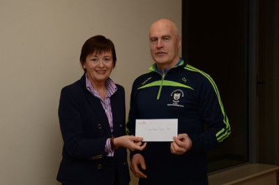 Presenting the sponsorship cheque was Brenda Nicholson (Finance Manager, CareerWise Recruitment) to Colm Honan (Clare Camogie Manager)