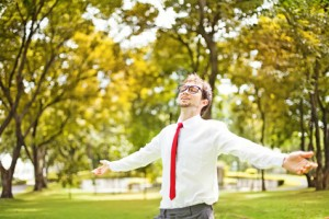 businessman refreshing in autumn park or forest
